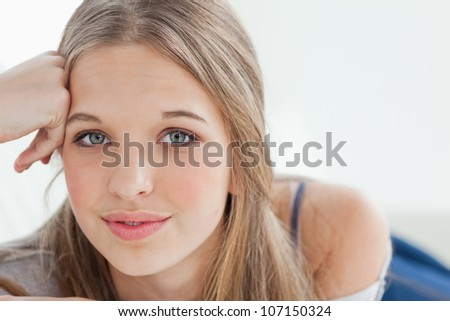 A close up shot of a girl looking into the camera - stock photo
