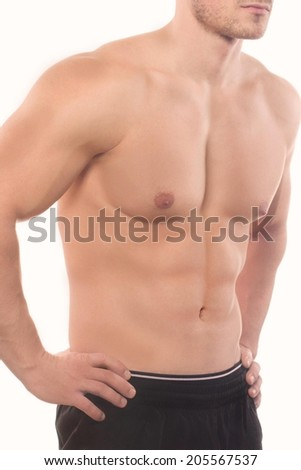 A close up shot of a mans upper body below the neck. on a white background. studio shoot