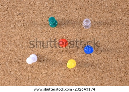 A close up shot of a notice board pins - stock photo