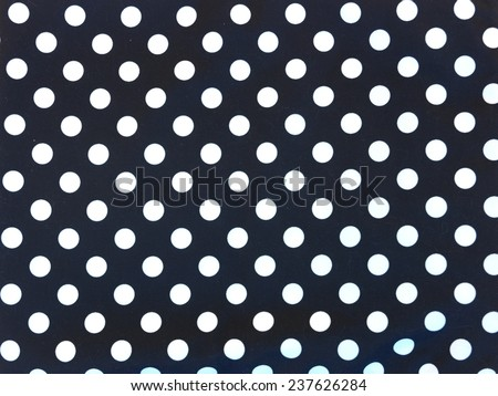 A close up shot of a polka dot background - stock photo