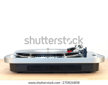 A close up shot of a record turntable - stock photo