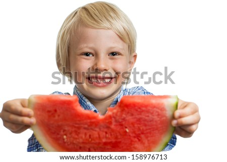 A close-up shot of a smiling cute boy holding out a nibbled water melon. Isolated on white.