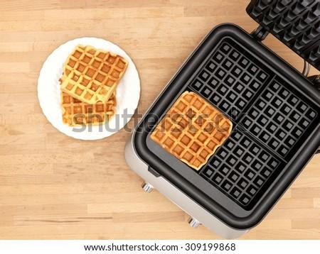 A close up shot of a waffle iron - stock photo