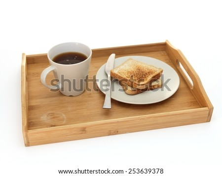 A close up shot of a wooden breakfast tray - stock photo