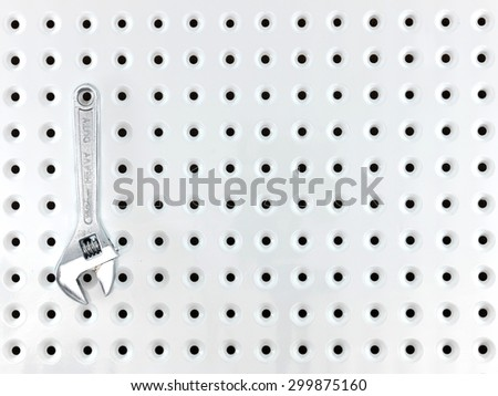 A close up shot of a workshop peg board - stock photo