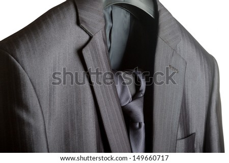 A close-up shot of an elegant formal mens suit with a tie