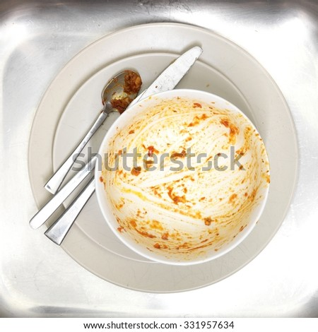 A close up shot of dirty dishes - stock photo