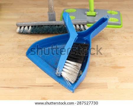 A close up shot of household floor cleaning items - stock photo