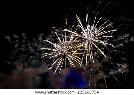 A close-up shot of sparkling Fireworks bursting out into beautiful shapes - stock photo