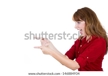 A close-up side view portrait of a cute young redhead woman pointing with her two fingers and something, isolated on a white background with plenty of copy space - stock photo
