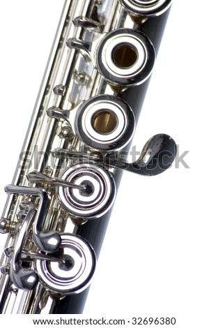 A close up silver flute isolated against a white background in the vertical format.