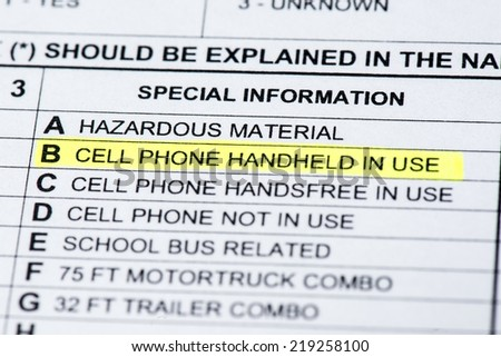 A close up the cell phone section on  a police collision report. - stock photo