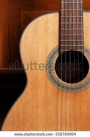 a close up to a guitar with blur background - stock photo