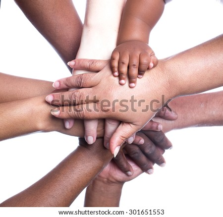 A close up view of a large group of people of mixed races, genders and ages holding hands in a supportive manner.