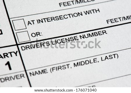 A close up view of a traffic collision report form.