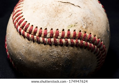 A close up view of a weathered baseball. - stock photo