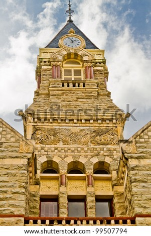 A close-up view of the clock tower atop the Fayette County Courthouse in La Grange, Texas showing details in the architecture.