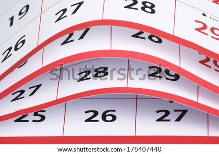 A close up view of the open pages of a calendar with the date numbers visible - stock photo