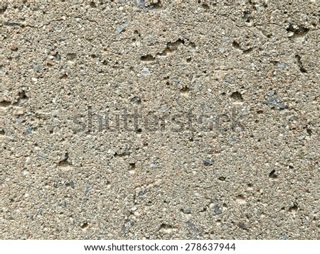 A close view of a cement concrete wall. - stock photo