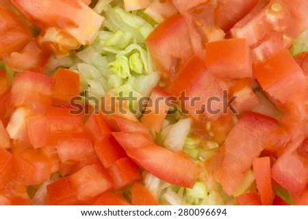 A close view of a fresh cut lettuce and tomato salad. - stock photo