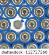 A close view of several AA size batteries with one negative side up and the remainder positive side up. - stock photo