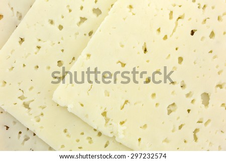 A close view of three slices of Havarti cheese. - stock photo