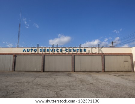 A closed auto service center building.