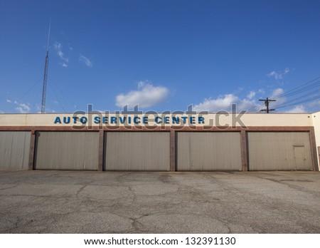 A closed auto service center building. - stock photo