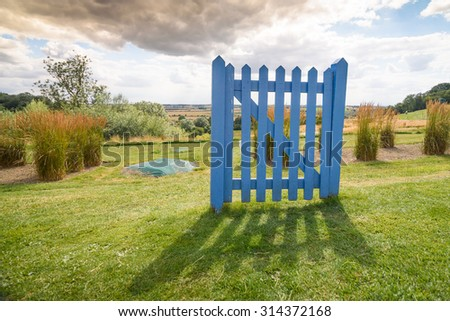 A closed gate in an open field. Could be used as, thinking outside the box, around a problem, psychology, careers, retirement, etc..