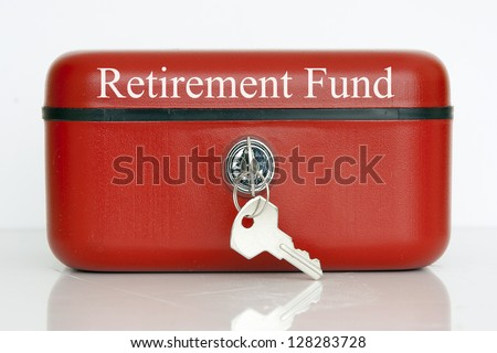 A closed red metal cash tin with Retirement Fund notice against a white background - stock photo