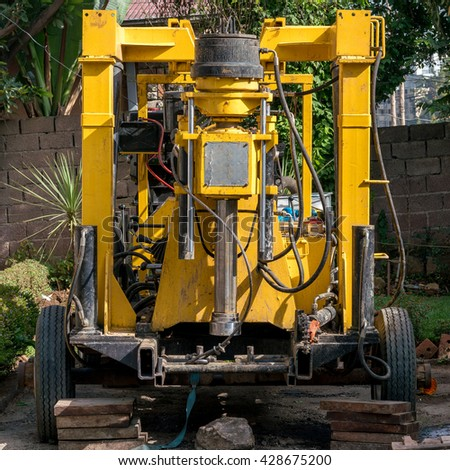 A closer look at the inner workings of a hydraulic construction machinery - stock photo