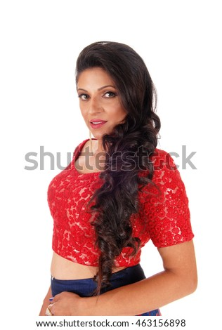 A closeup image of a very lovely woman with long curly black hair standing