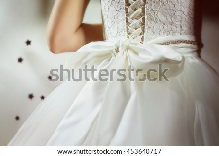 A closeup image of bride in luxury wedding dress.