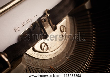 A Closeup image of the typebars and ribbon of an old style typewriter and paper with the text: My Story... (Shallow Depth of Field) - stock photo