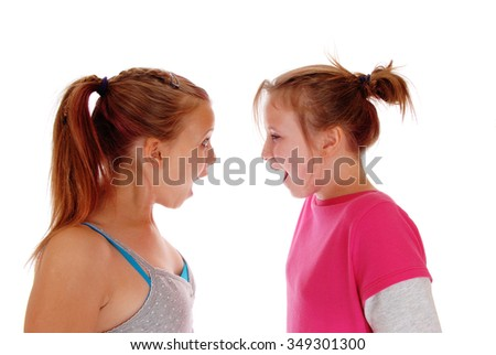 A closeup image of two sisters shouting at each other, with blondponytail's, isolated for white background. - stock photo