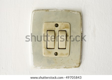 A closeup in a old light switch - stock photo