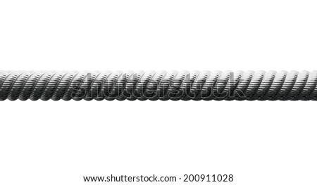 A closeup of a coarse metal cable on an isolated background - stock photo
