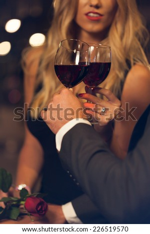 A closeup of a couple celebrating their engagement - stock photo