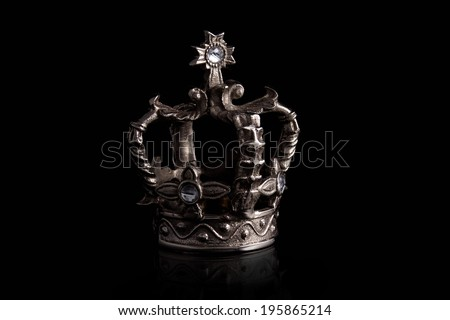 a closeup of a crown with black background - stock photo
