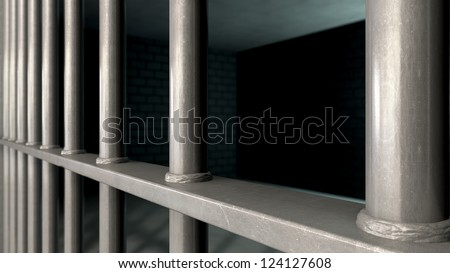 A closeup of a jail cells iron bars - stock photo
