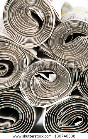A closeup of a stack of  rolled up newspapers ready to be delivered - stock photo