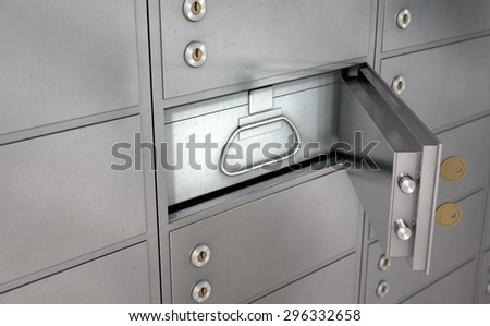 A closeup of a wall of closed metal safety deposit boxes with one open revealing its contents inside - stock photo