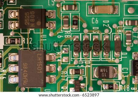 a closeup of an electronic circuit board - stock photo