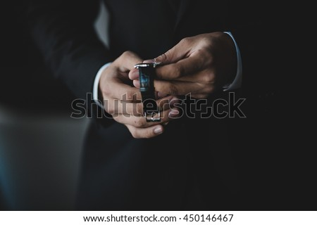 A closeup of man's hands holding a watch
