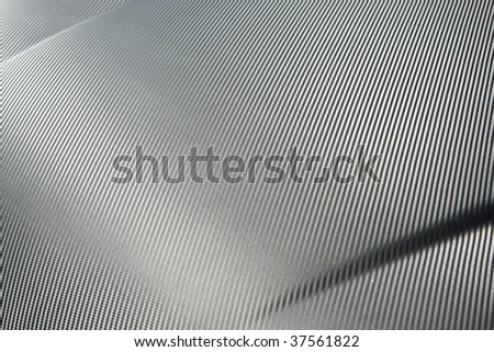 A closeup of real carbon fiber material, an excellent texture or background. Shallow depth of field. - stock photo