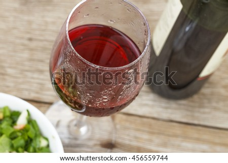 a closeup of red wine and a salad of fresh vegetables, Proper nutrition or a gala dinner,