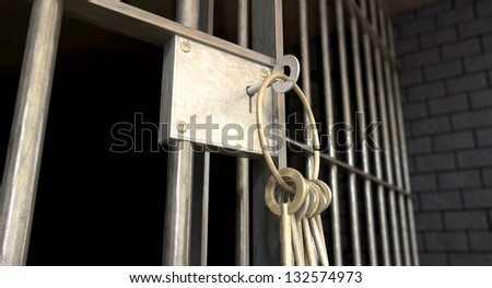 A closeup of the lock of a  jail cell with iron bars and a bunch of key in the locking mechanism with the door open