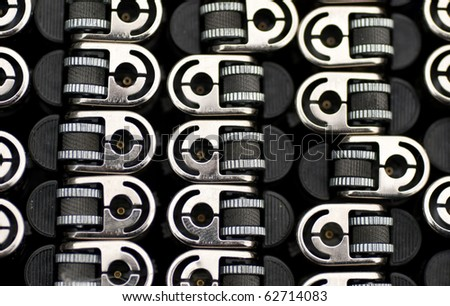 a closeup of the top of cigarette lighters - stock photo
