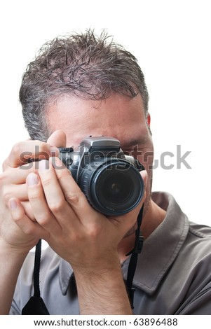 A closeup on the face of a man with a digital slr camera up to his eye, in the process of taking a picture, isolated on white.