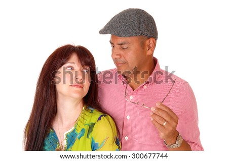 A closeup picture of a middle age couple standing isolate for white background looking at each other.  - stock photo
